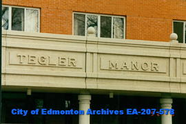 Tegler Manor - architectural detail of front entrance and name plate.