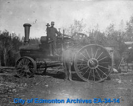 Willie and Leonard McDougall with Steam Traction Engine.