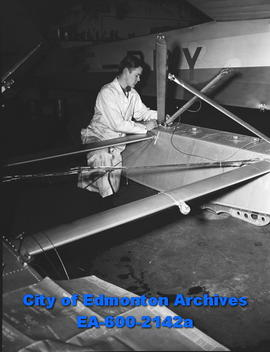 Airport shots: George Malone working on plane.