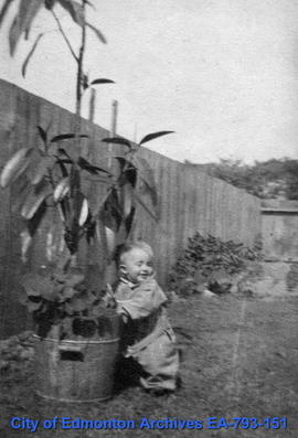 Toddler with potted plant