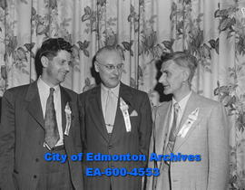 Alberta Credit Union. Three men with delegate ribbons.