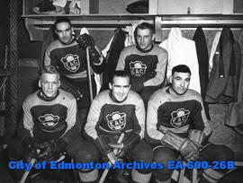 1934 EAC hockey team at exhibition game with 1939 Capitols hockey team (L-R, B-T): Morey Rimstad,...