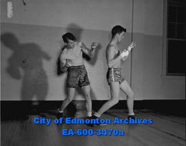 Edmonton Boys Boxing Club. Bill Spring (left) prepares for fight.