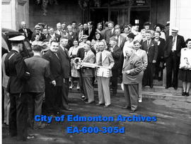 Members of the visiting Lions Club party on the steps of the Macdonald Hotel as Mayor Harry Ainla...