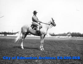 """Shorty"" Allen riding horse ""Blonde Sam,"" Edmonton Exhibition Association's l..."