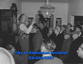 Auctioneer Arthur Cload conducts auction at the late Dr. Egerton L. Pope's residence.