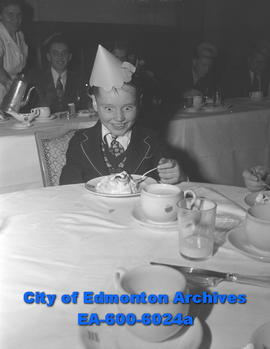 Edmonton Bulletin carriers' banquet. Jim McNeill, 10, enjoying his baked Alaska.