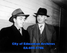 """Tiny"" Thompson, right, chief scout for the Chicago Black Hawks, sponsor of the Wetaski..."