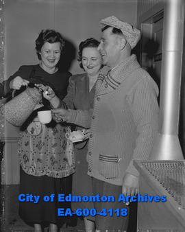 Curling - Mrs. Herb Coxford and Mrs. Jack Gowan serve coffee to Billy Rose.