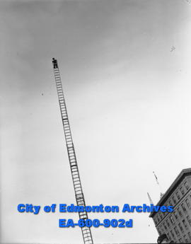 A member of Edmonton's fire department stands at the top of a new all-steel 100 foot aerial ladde...