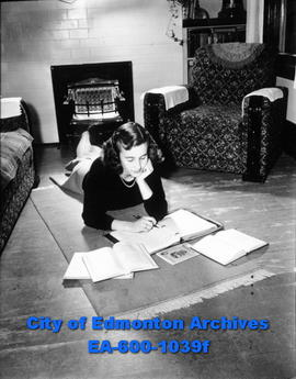 Miss Edmonton of 1948, Joan Farley, doing homework and studying.