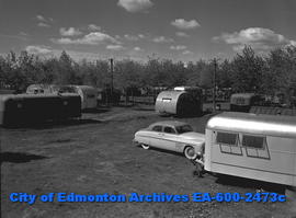 Trailer Camp Feature:  Shot of campsite with trailers.