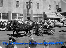 Horse-drawn wagon in parade.