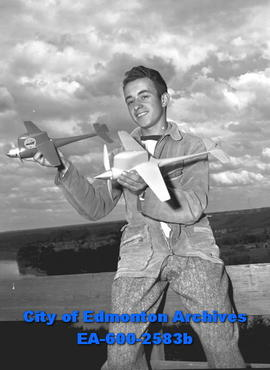 """Edmonton Aeroneers to 'Fly' in Bulletin's Air Show Here"".Bob Randall with model airpla..."