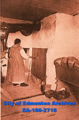Madame Gagnon baking bread, Saint-Pierre.