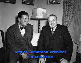 Gene Tunney, left, former world's heavyweight boxing champion, arrives in Edmonton to inspect gol...