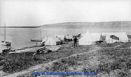 Esquimoux camp at Arctic Red river with Rev. Mr. Fry in foreground