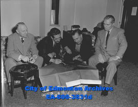 Negotiator L.E. Detwiler (far right) and architect A. Gordon Lorimer (second from the left) with ...