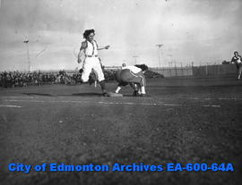 1947 Senior Ladies Fastball League: action shot of Isabel Whitley (left) and Merrie Mercer (right).