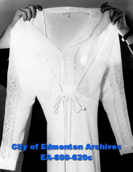 Edmonton Bulletin writer Ted Horton, on an assignment to see what stores have in their lingerie s...