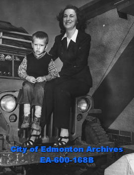 Mrs. L .R. Laudon and son Bobby with jeep en route to Yellowknife; photographed in Edmonton.