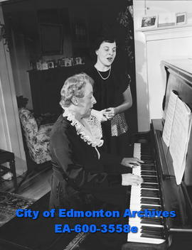 Women's Page: Music student Donna Gail Richards, sings as mother plays piano.