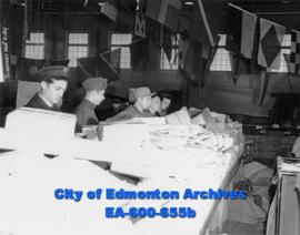 Sorting Christmas parcels at HMCS Nonsuch's drill hall, temporarily used by the Edmonton post off...