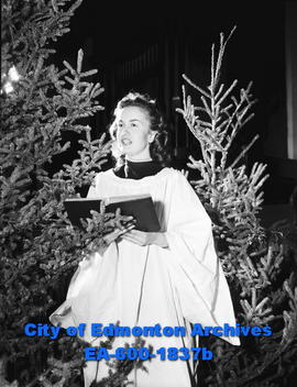Ruth Gilles in church sings Christmas carols.