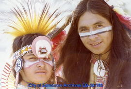 Two Indigenous men wearing traditional clothing