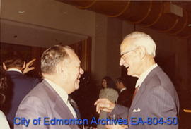 Edmonton Mayor William Hawrelak speaks with former Lieutenant Governor Grant MacEwan