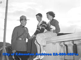 RCMP Const. E.C. Hasselfield with safety patrollers Elmer Ball and Ada Cunningham.