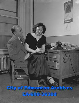 Stenographer feature: secretary sits on boss' lap.