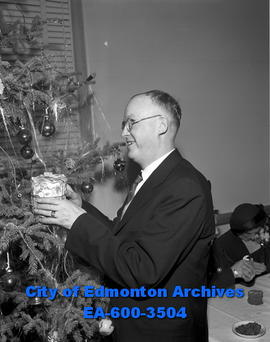 CNIB Christmas party. Allan De Coursey with Christmas gift.