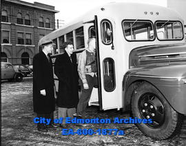 Hockey bus for the Waterloo Mercurys. L-R: Harry Allen, Pete Wright, and Bill Dawe.