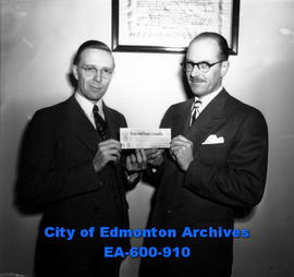 Premier Ernest Manning presents a cheque to the Canadian Red Cross.