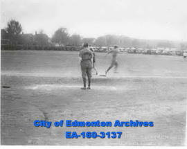 """An Eskimo Touches First Base"" - Girls Softball at Boyle Street."