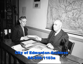 True Story: Thomas Dean gets his cheque for $2.50 by acting Mayor Ald. Sid Parsons.