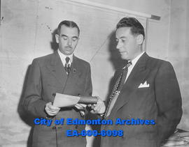 Alderman Duncan Innes (left) is sworn in by city clerk George Docherty.
