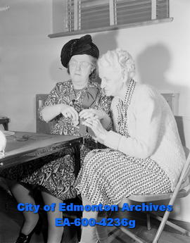 Women's Page: Blind feature - blind teacher E.J. Fisher teaches Fern Finch how to knit.
