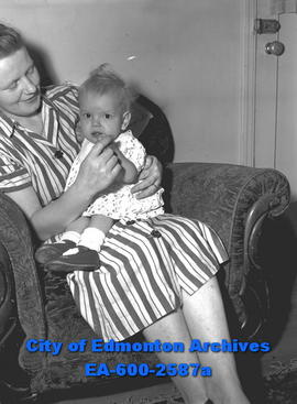 """Blue Baby Gets Chance to Fight For Her Life"". Mrs. Fred Madsen with daughter Terry."