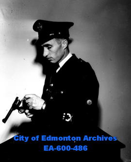 Constable Bill Fedoruk, city policeman and winner of the crossed silver revolvers badge for scori...