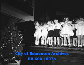 Youngsters from Edmonton College kindergarten sing Christmas songs.