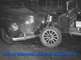 Wrecked automobiles at 109 Street and 104 Avenue, driven by Gordon Kilfoyle and W. J. Bowling.