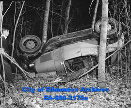 Car accident - Jalopy plunged into 20-foot ravine at 101 Avenue and 149 Street.