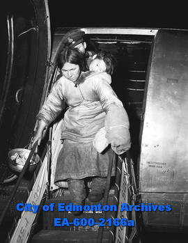 Eskimo village struck by disease: Ishwomiatook with her sick child getting off plane
