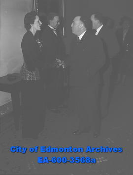 """New Year Reception Draws 400"". L-R: Joseph Strother, Ernest Manning and his wife."