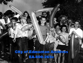Children in balloon blowing contest at the annual Edmonton Police Amateur Athletic Association pi...