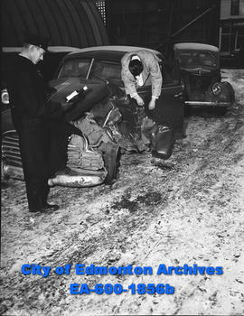 Const. Barnie Nicholson stands by car that was in an accident before warning about careless drivi...