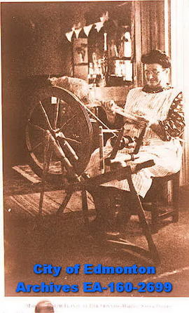 Madame Joseph Plante at her spinning wheel.