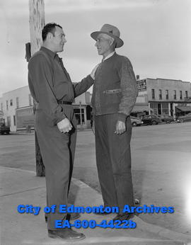"Camrose residents welcome back Mr. ""Murder"" Mills to town. Al Mills (left) and Pete Dec..."